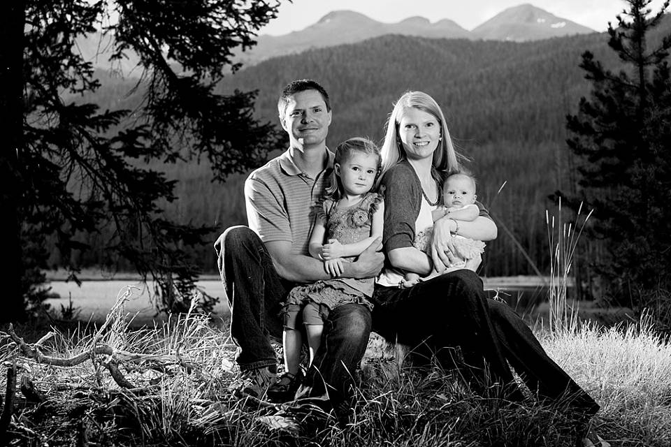 Black and white family portrait in the mountains