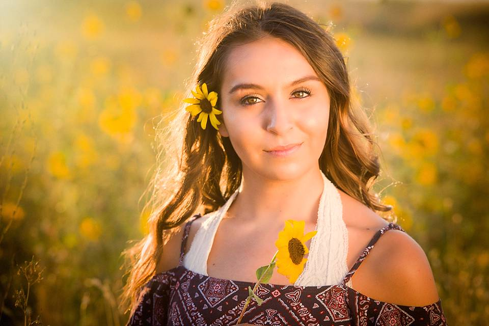 Senior Portrait outside in sunflower field