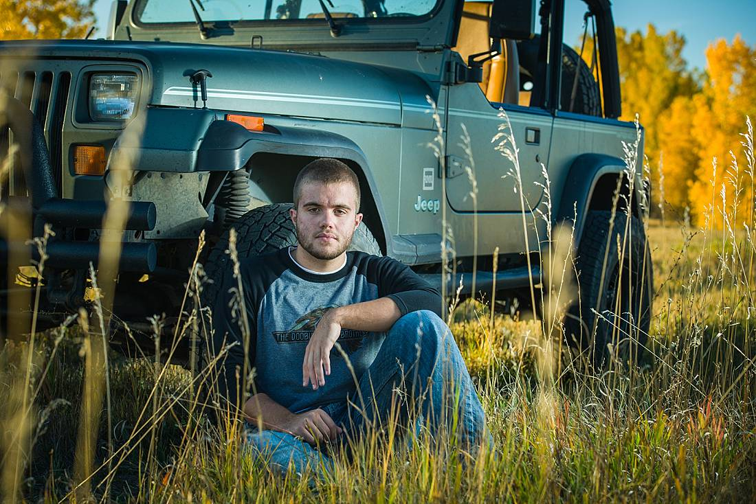 Erie high scool senior boy in erie co with Jeep on a fall day