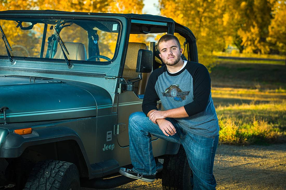 Erie high school senior with jeep on a fall afternoon