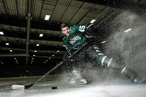 hockey player spraying ice