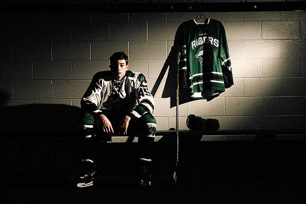 A locker room shot of a hockey player