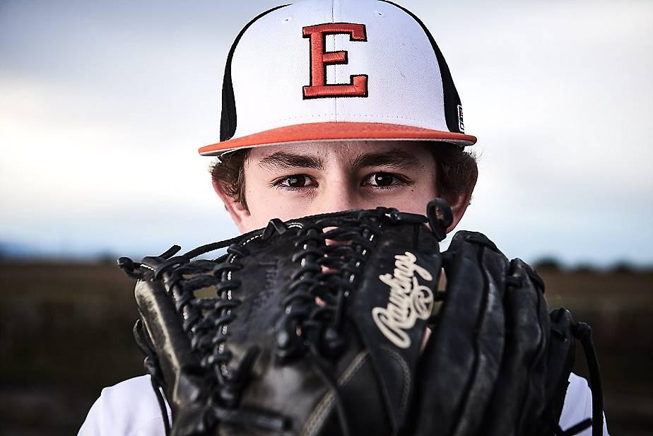 senior baseball plater staring over his glove